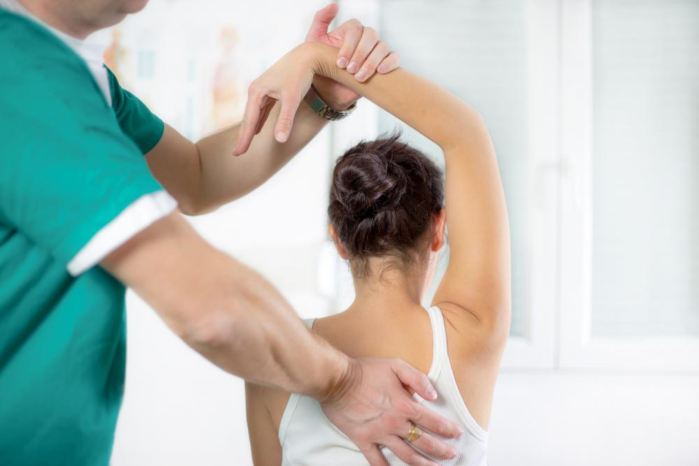 woman receiving prenatal chiropractic care from chiropractor in Tracy